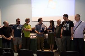 La giuria e lo staff assieme al vincitore Marco Stefanni